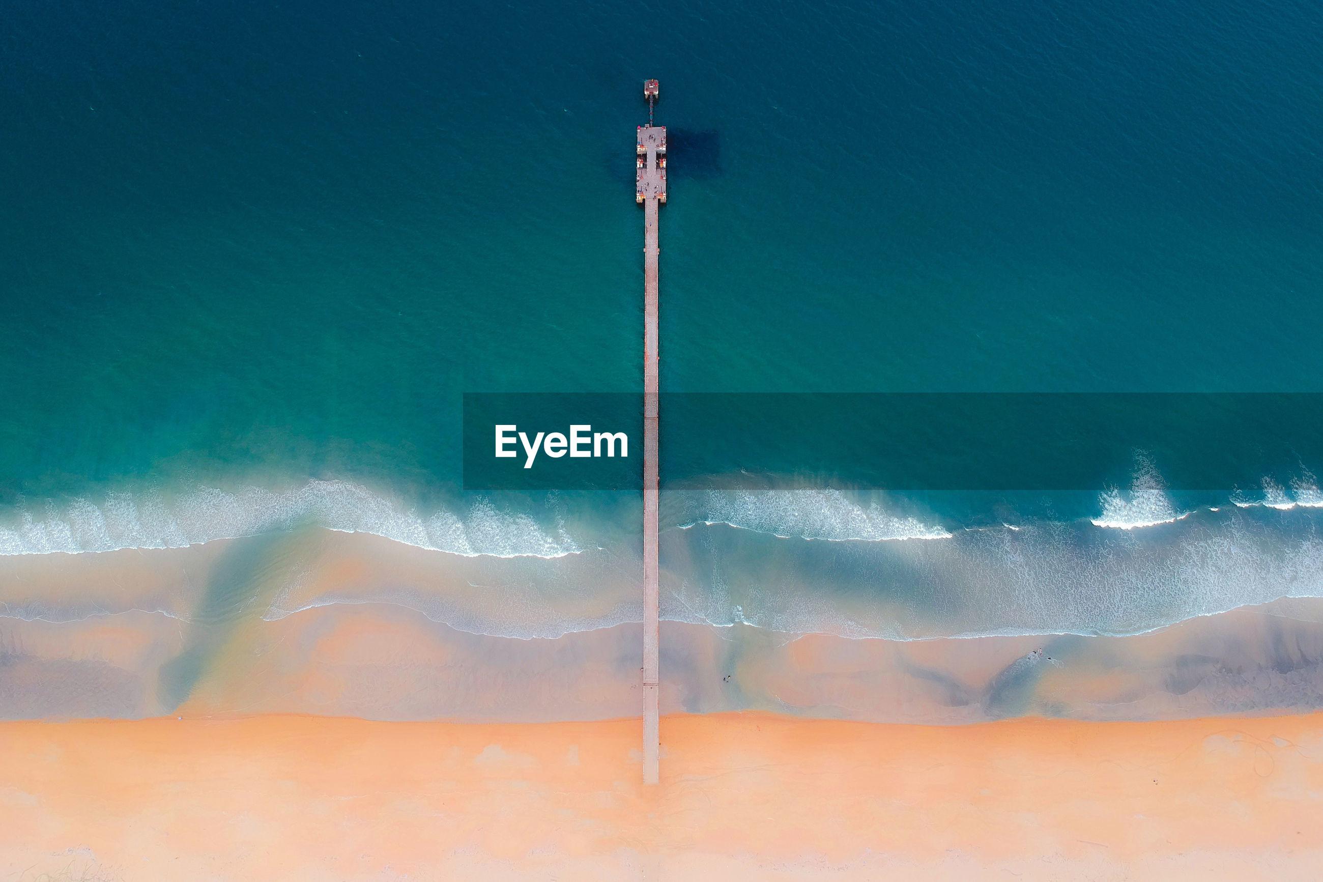 Drone shot of pier over sea