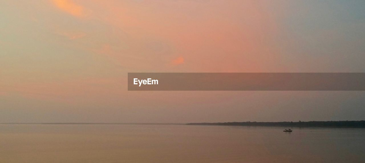 water, sky, scenics - nature, beauty in nature, tranquil scene, tranquility, sea, sunset, waterfront, horizon, idyllic, horizon over water, nature, reflection, no people, cloud - sky, orange color, non-urban scene, outdoors