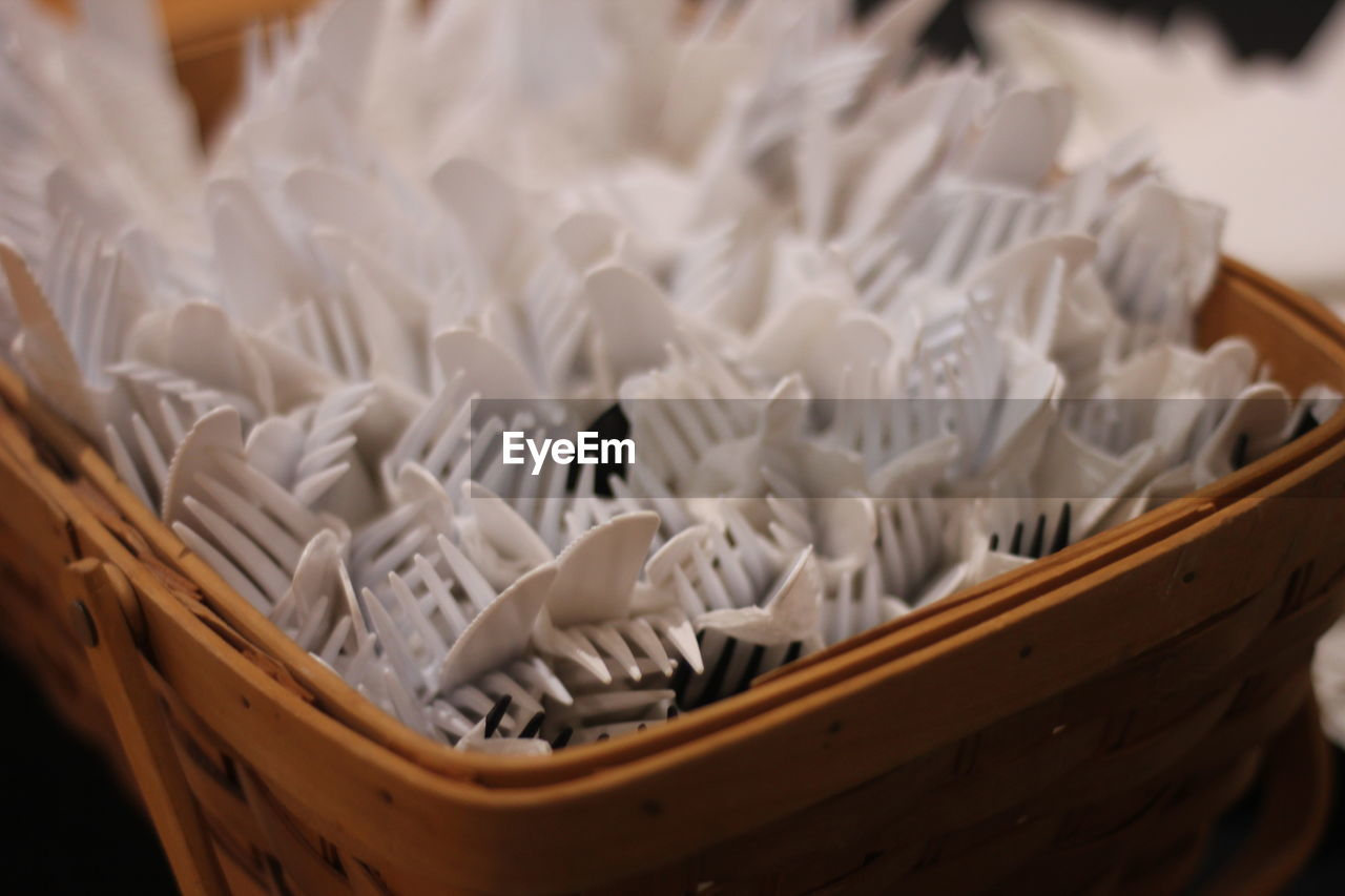 container, indoors, white color, basket, no people, wood - material, still life, large group of objects, selective focus, pattern, high angle view, close-up, focus on foreground, wicker, abundance, table, group, celebration, art and craft, absence, temptation