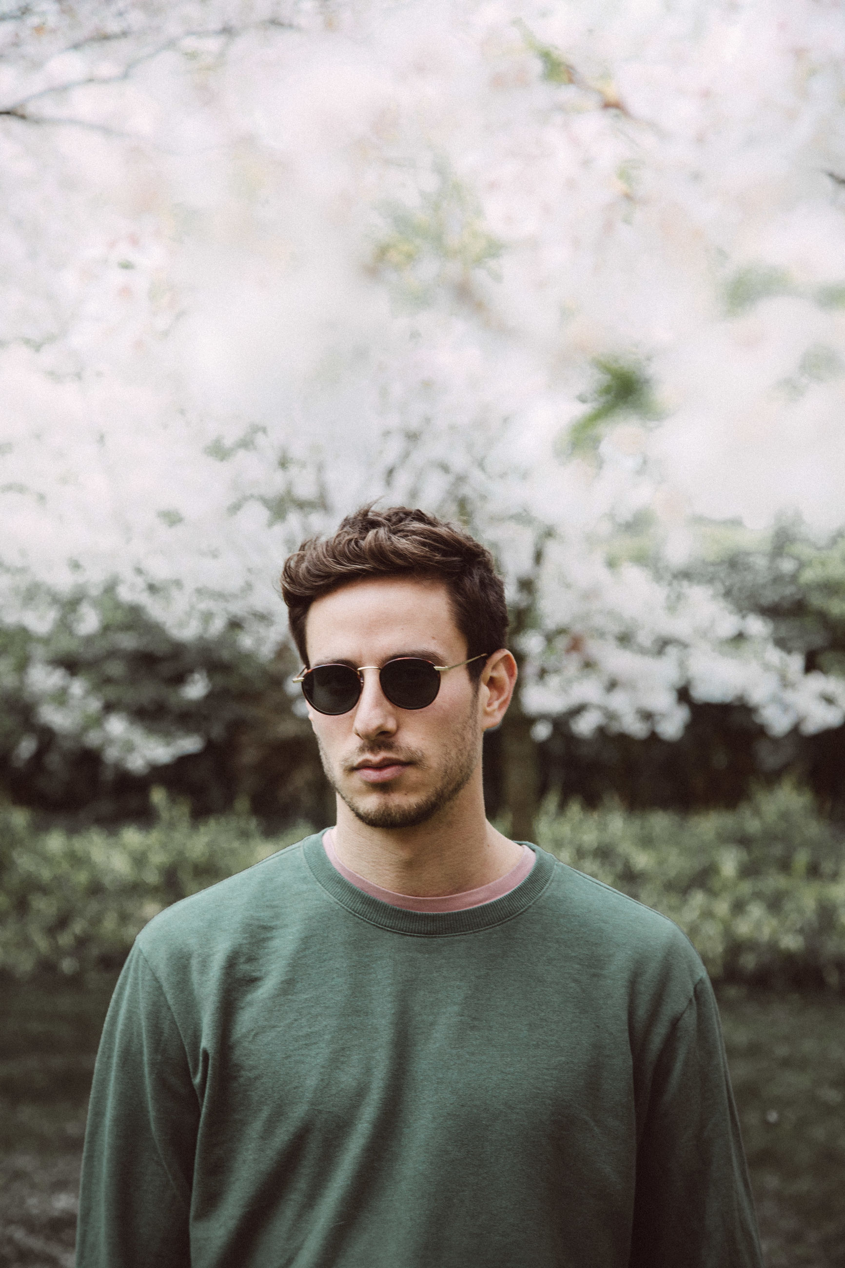Portrait of young man wearing sunglasses standing in park