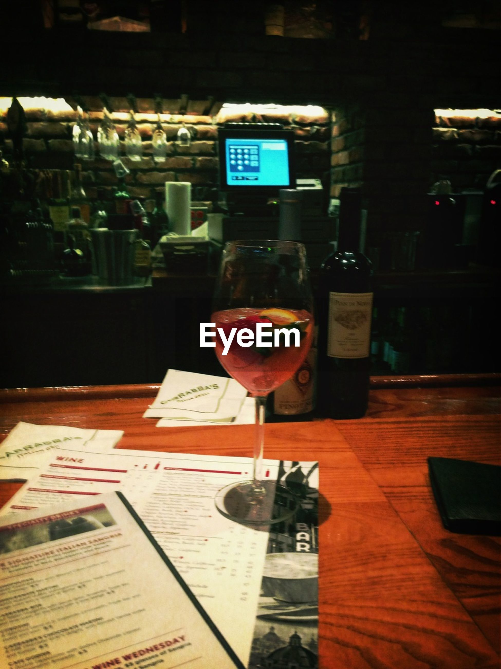 food and drink, drink, table, indoors, restaurant, text, refreshment, western script, drinking glass, communication, freshness, still life, glass - material, alcohol, cafe, incidental people, close-up, transparent, no people, focus on foreground