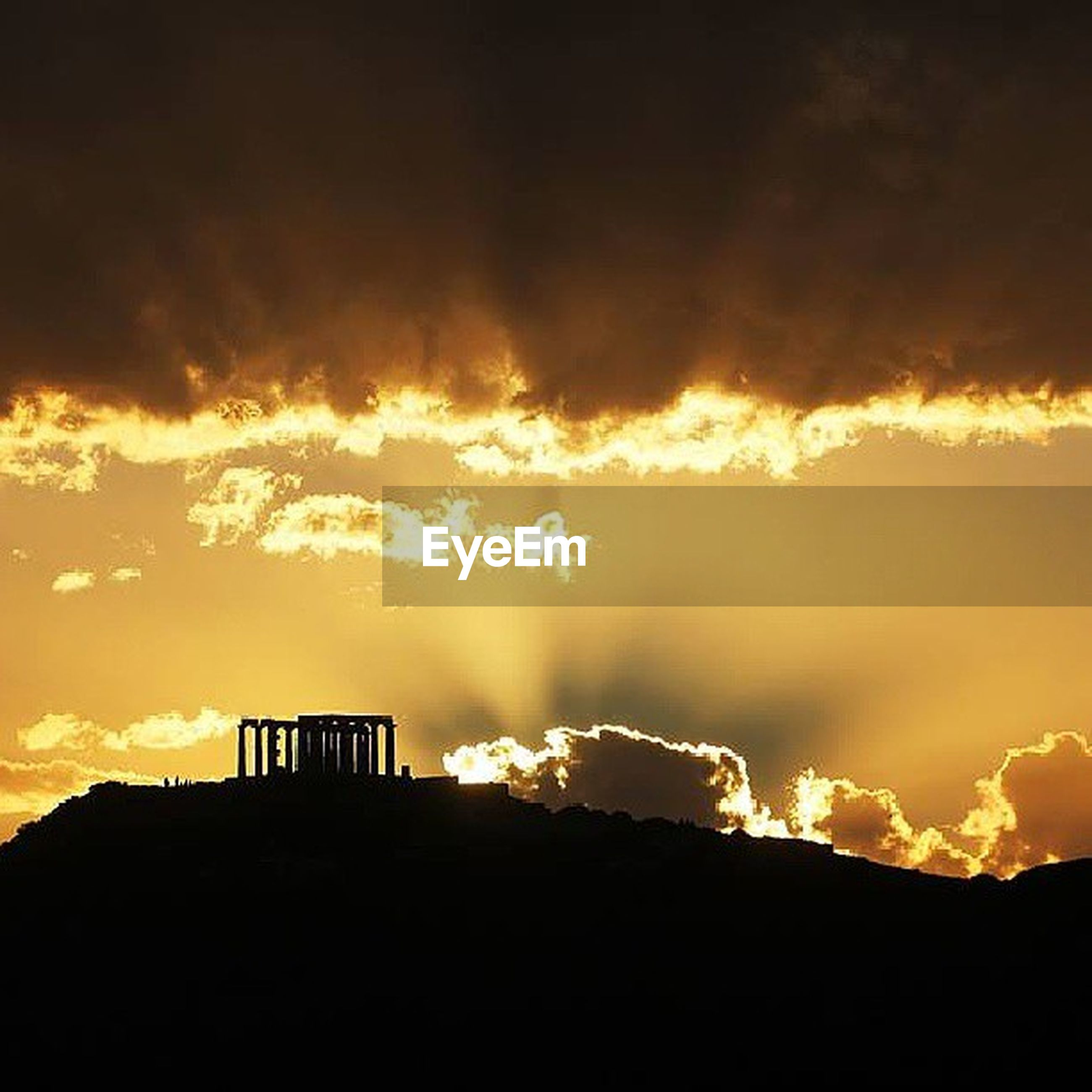 sunset, sky, built structure, cloud - sky, architecture, silhouette, building exterior, sun, sunbeam, orange color, low angle view, cloudy, sunlight, scenics, house, beauty in nature, dramatic sky, cloud, nature, outdoors