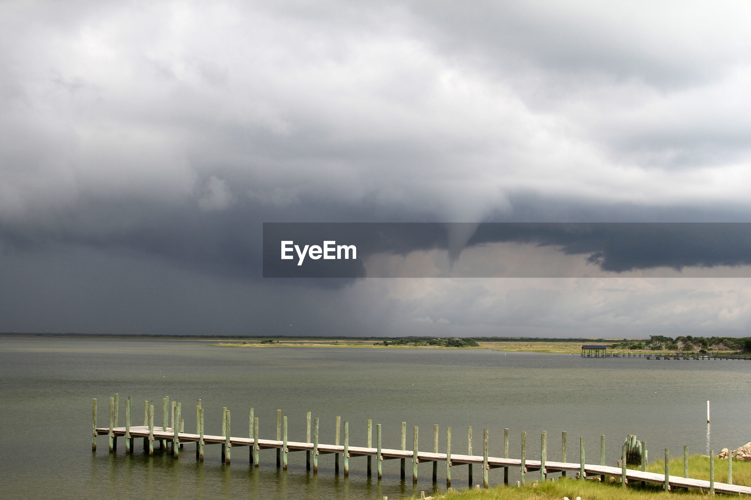 Storm clouds and water spout forming over ocean