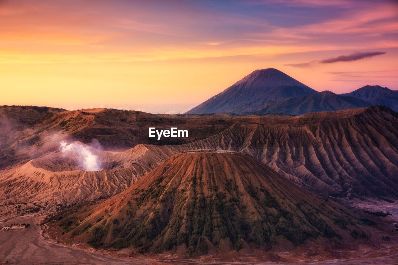 Panoramic View Of Volcanic Crater Against Sky During Sunset
