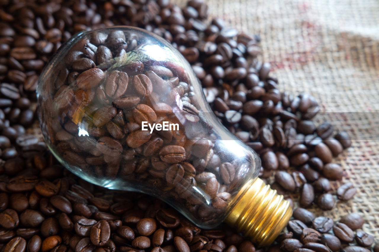 food, food and drink, freshness, roasted coffee bean, still life, brown, close-up, indoors, no people, coffee - drink, table, coffee, healthy eating, large group of objects, wellbeing, high angle view, abundance, seed, focus on foreground, raw food, caffeine