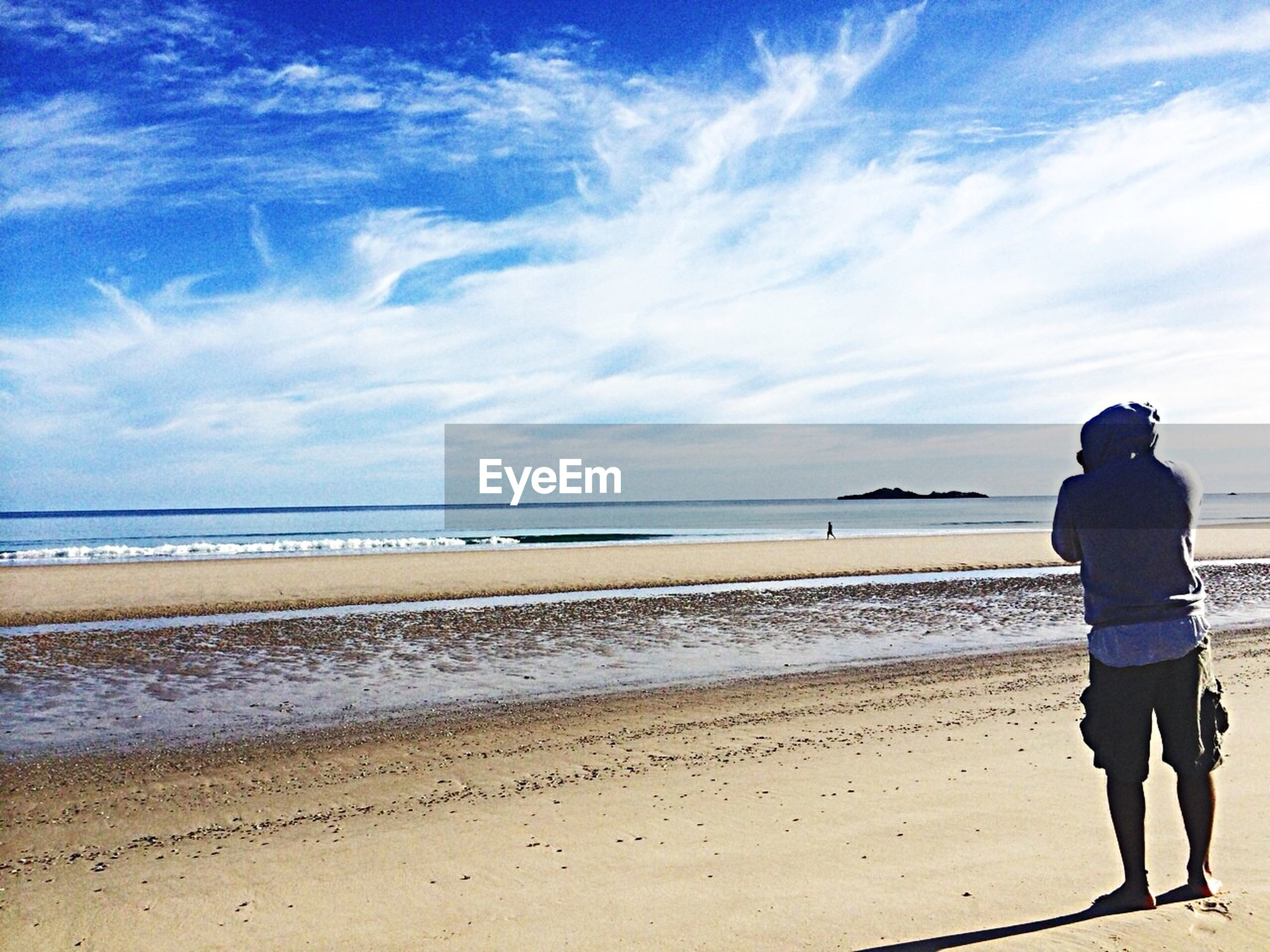 beach, sea, sky, water, horizon over water, shore, full length, lifestyles, leisure activity, rear view, sand, standing, tranquility, cloud - sky, tranquil scene, men, scenics, beauty in nature