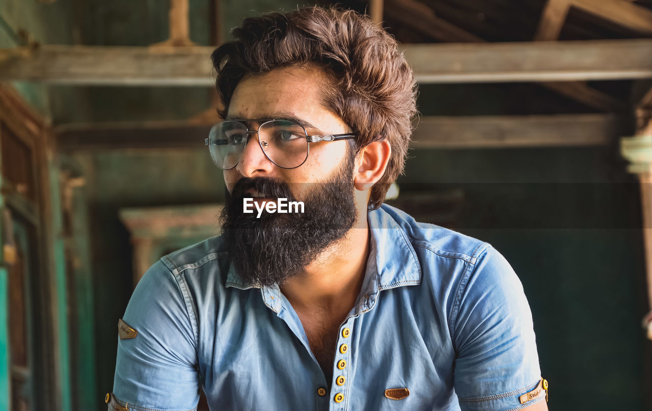Close-up of bearded man with eyeglasses