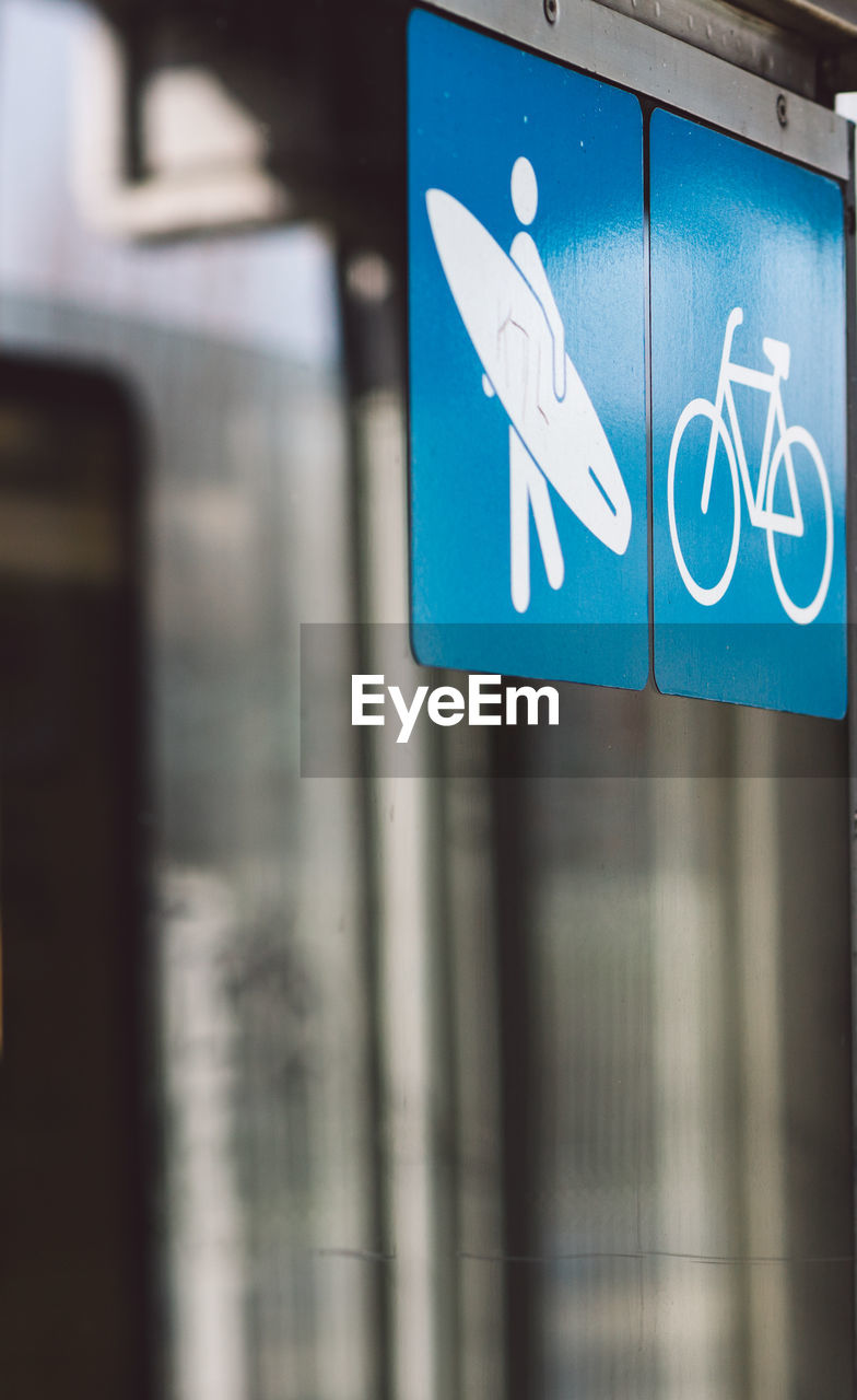 sign, communication, blue, no people, information, information sign, representation, human representation, text, symbol, guidance, day, close-up, road, indoors, wall - building feature, transportation, restroom sign, architecture