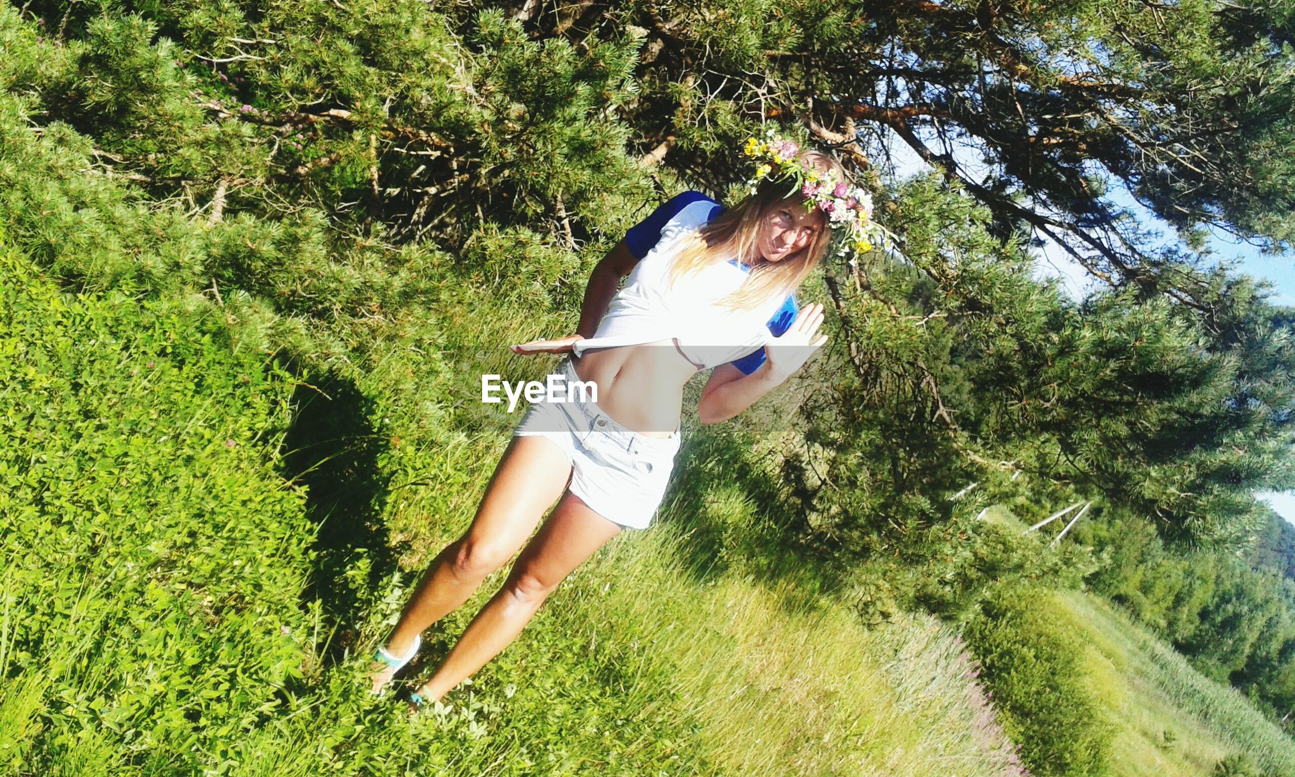 tree, grass, green color, growth, full length, one animal, lifestyles, leisure activity, sunlight, plant, nature, young adult, young women, outdoors, day, field, grassy, park - man made space