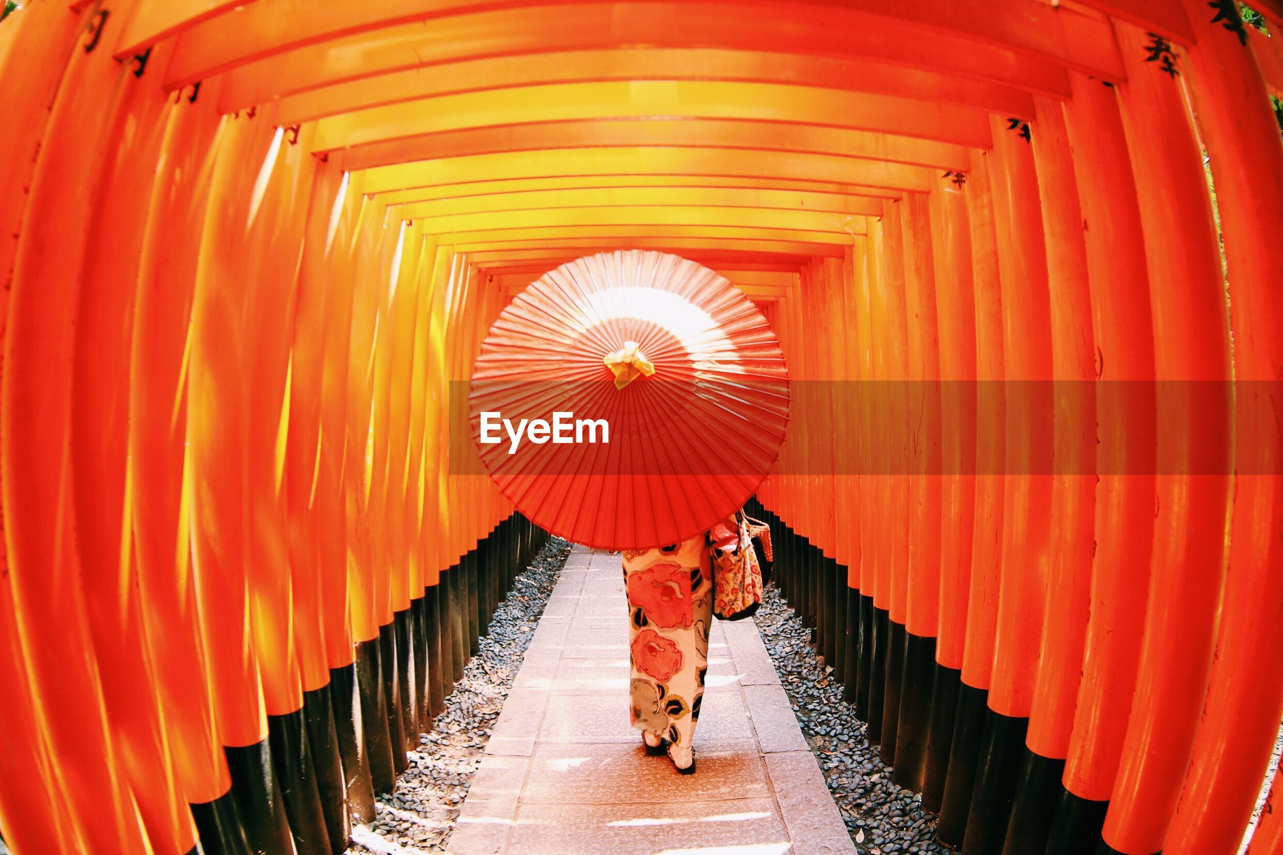 indoors, lifestyles, red, full length, leisure activity, the way forward, steps, men, in a row, orange color, rear view, walking, ceiling, built structure, architecture, person, steps and staircases, standing