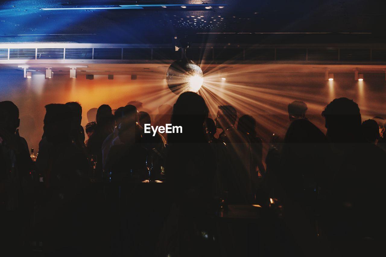 Silhouette people in nightclub