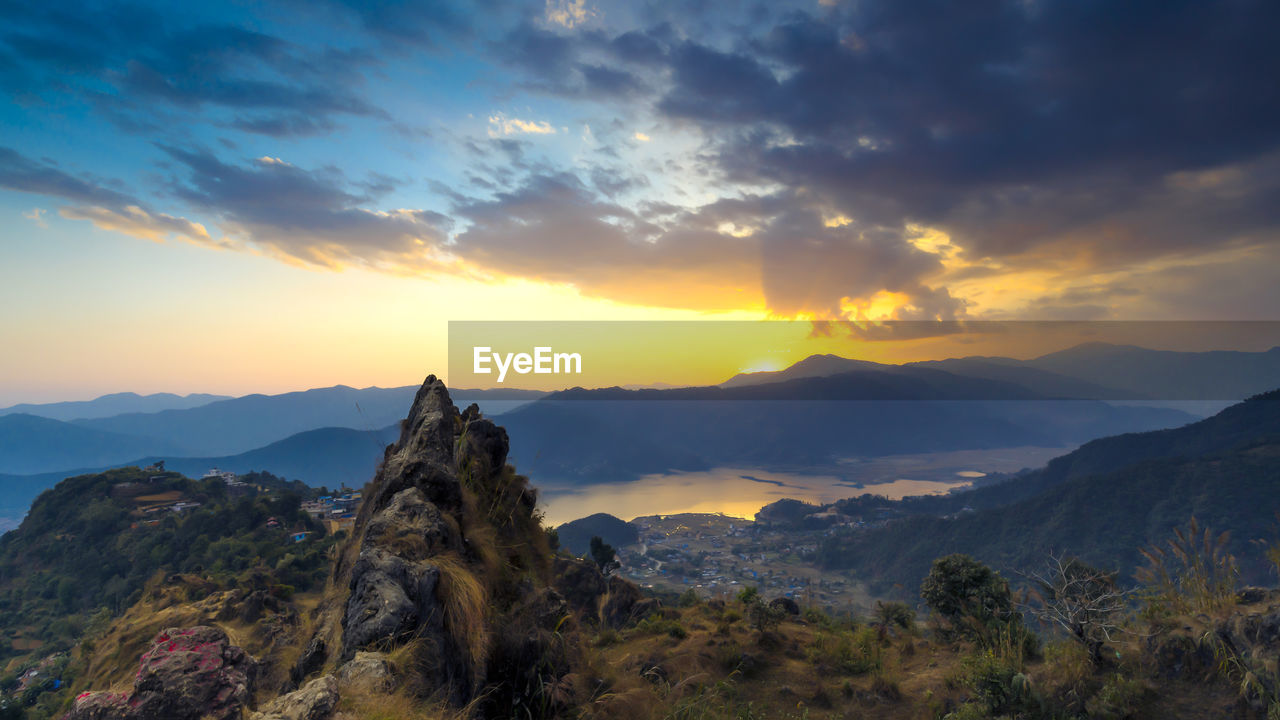 sky, sunset, mountain, scenics - nature, cloud - sky, beauty in nature, tranquil scene, tranquility, mountain range, environment, non-urban scene, nature, idyllic, landscape, orange color, no people, rock, remote, plant, outdoors, mountain peak