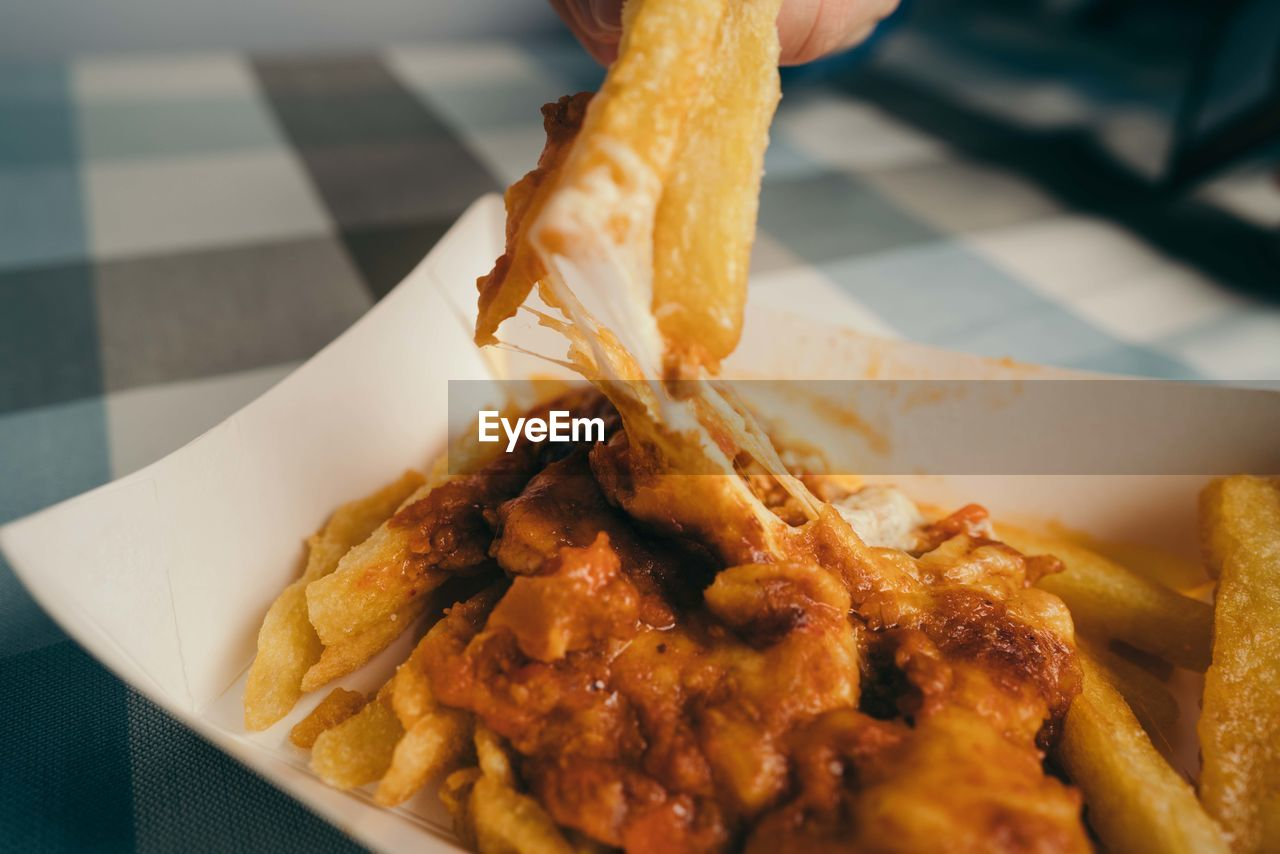 food and drink, food, ready-to-eat, freshness, close-up, french fries, one person, unhealthy eating, fast food, indoors, fried, human hand, hand, human body part, prepared potato, holding, potato, serving size, plate, deep fried, snack, take out food, temptation, finger