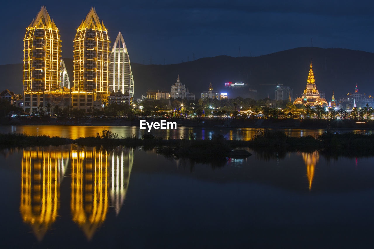 REFLECTION OF ILLUMINATED BUILDINGS AT WATERFRONT