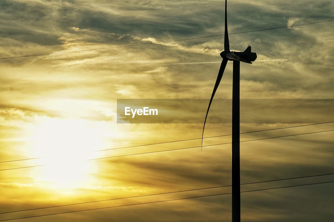 cloud - sky, sky, fuel and power generation, sunset, technology, electricity, nature, cable, low angle view, turbine, renewable energy, power supply, alternative energy, silhouette, wind turbine, beauty in nature, no people, environment, environmental conservation, connection, outdoors, sun