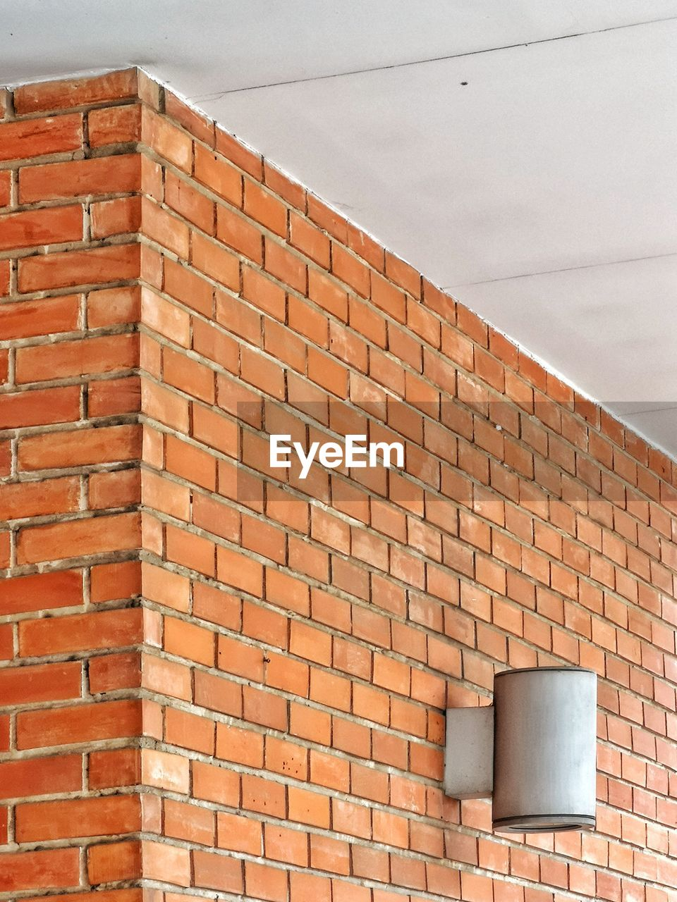 brick, wall - building feature, brick wall, built structure, wall, architecture, building exterior, no people, day, brown, pattern, low angle view, outdoors, roof, building, lighting equipment, shape, container, nature, window