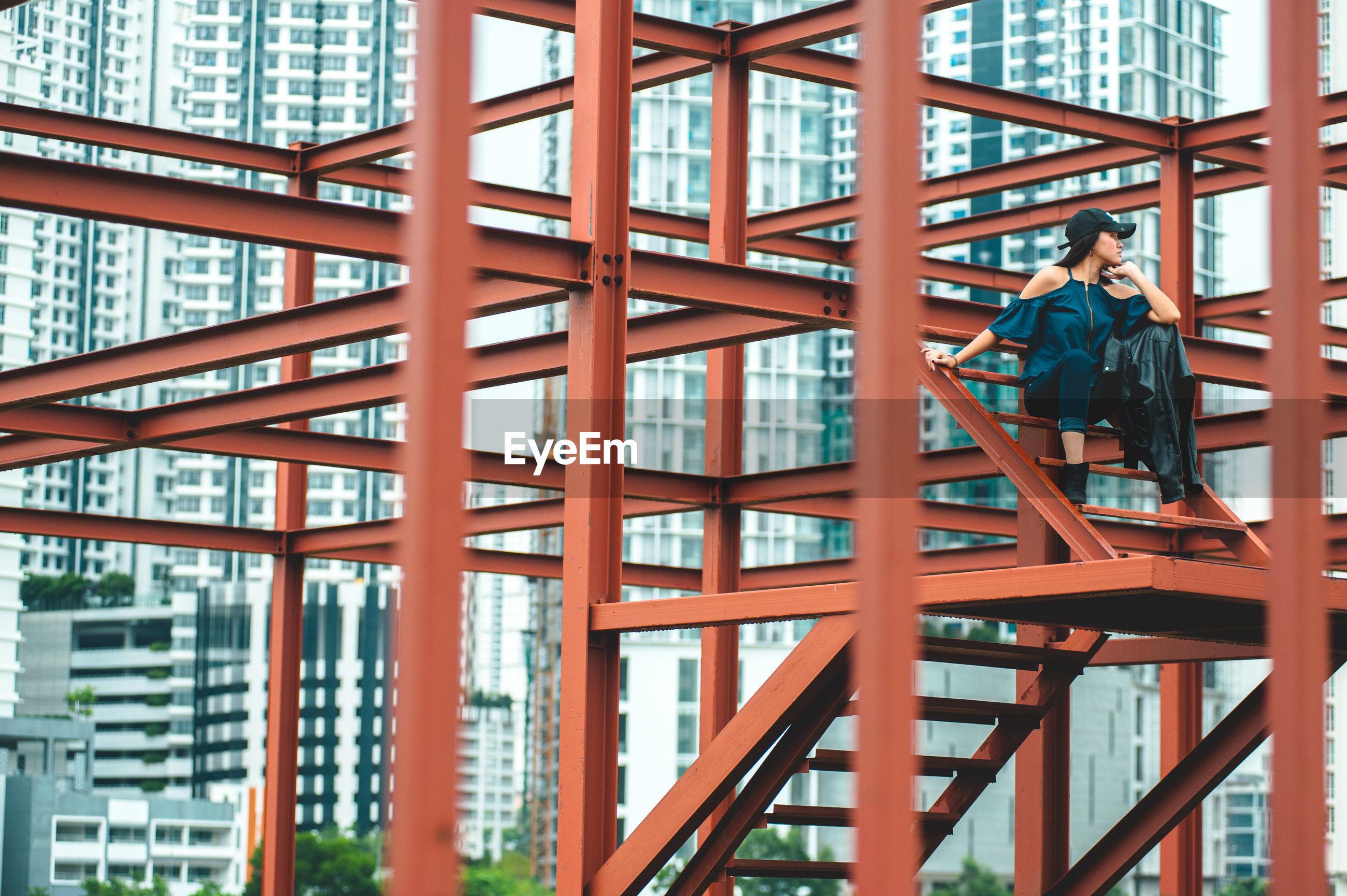 Portrait of young woman on built structure