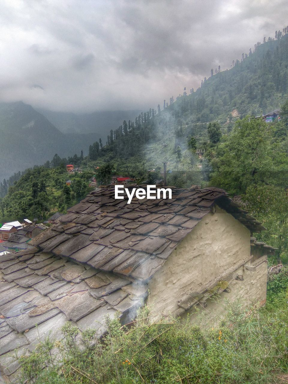mountain, day, weather, no people, architecture, built structure, tree, nature, outdoors, sky, roof, cloud - sky, beauty in nature, scenics, building exterior, growth, mountain range, water, tiled roof