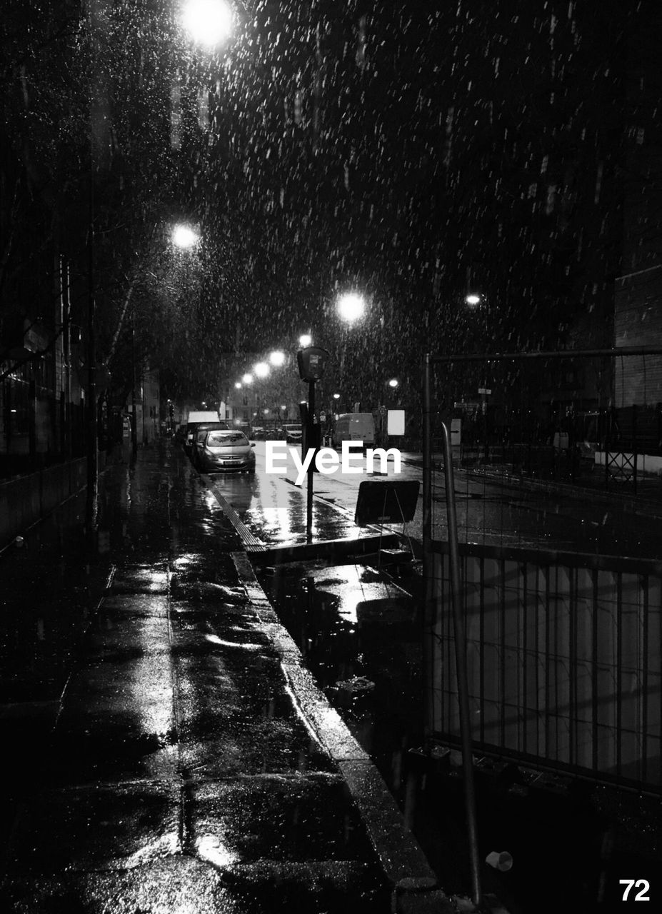 night, rain, illuminated, weather, wet, rainy season, street light, street, architecture, city, winter, outdoors, raindrop, built structure, road, snow, building exterior, snowing, water, no people, sky