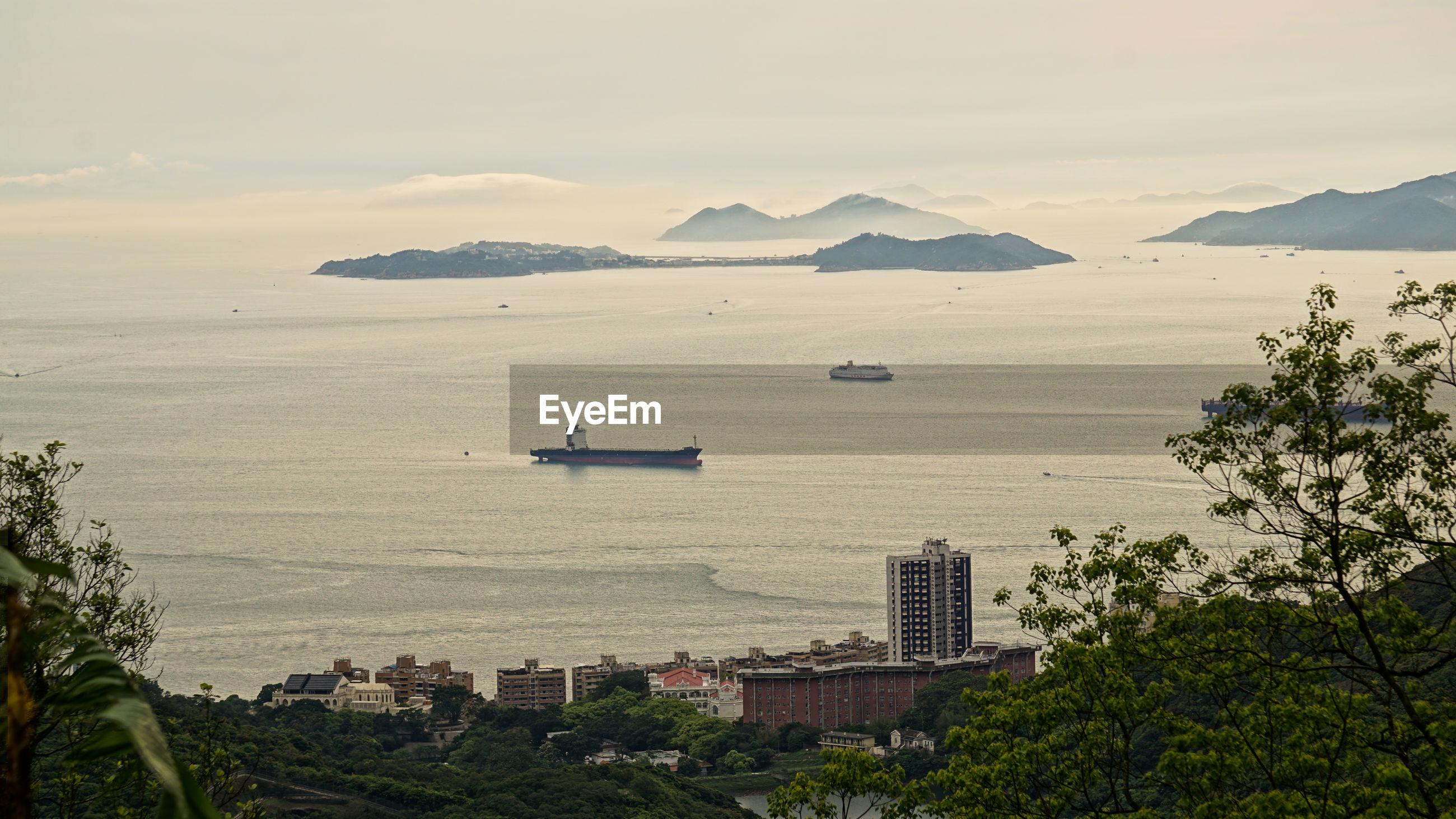 HIGH ANGLE VIEW OF CITY AND SEA