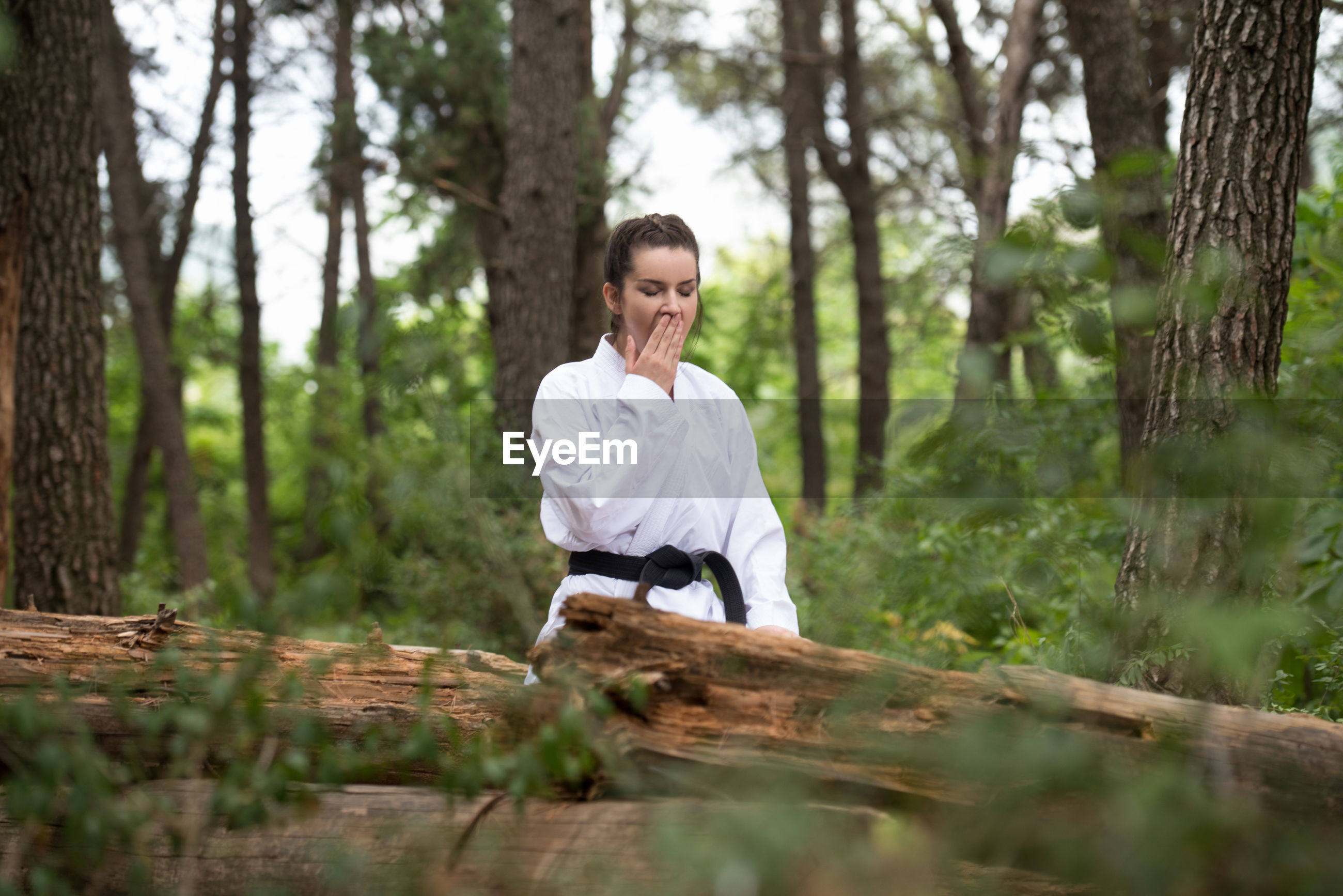 SMILING WOMAN IN FOREST