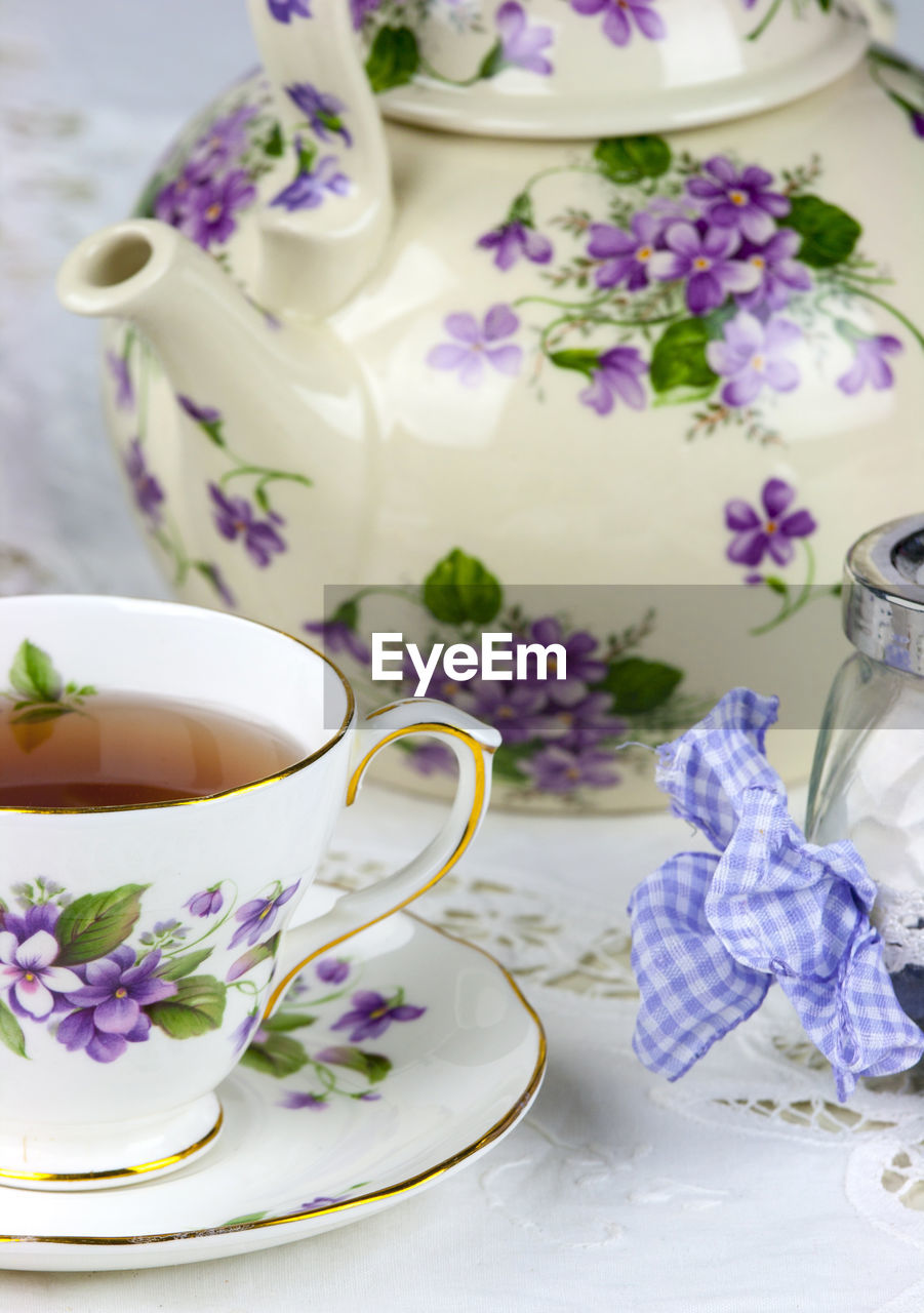Close-Up Of Elegant Retro Teapot On Table