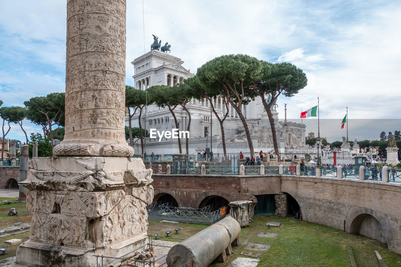 architecture, built structure, building exterior, history, the past, sky, nature, tree, cloud - sky, travel destinations, day, plant, city, building, art and craft, tourism, travel, incidental people, sculpture, water, outdoors, architectural column, ancient civilization, cannon