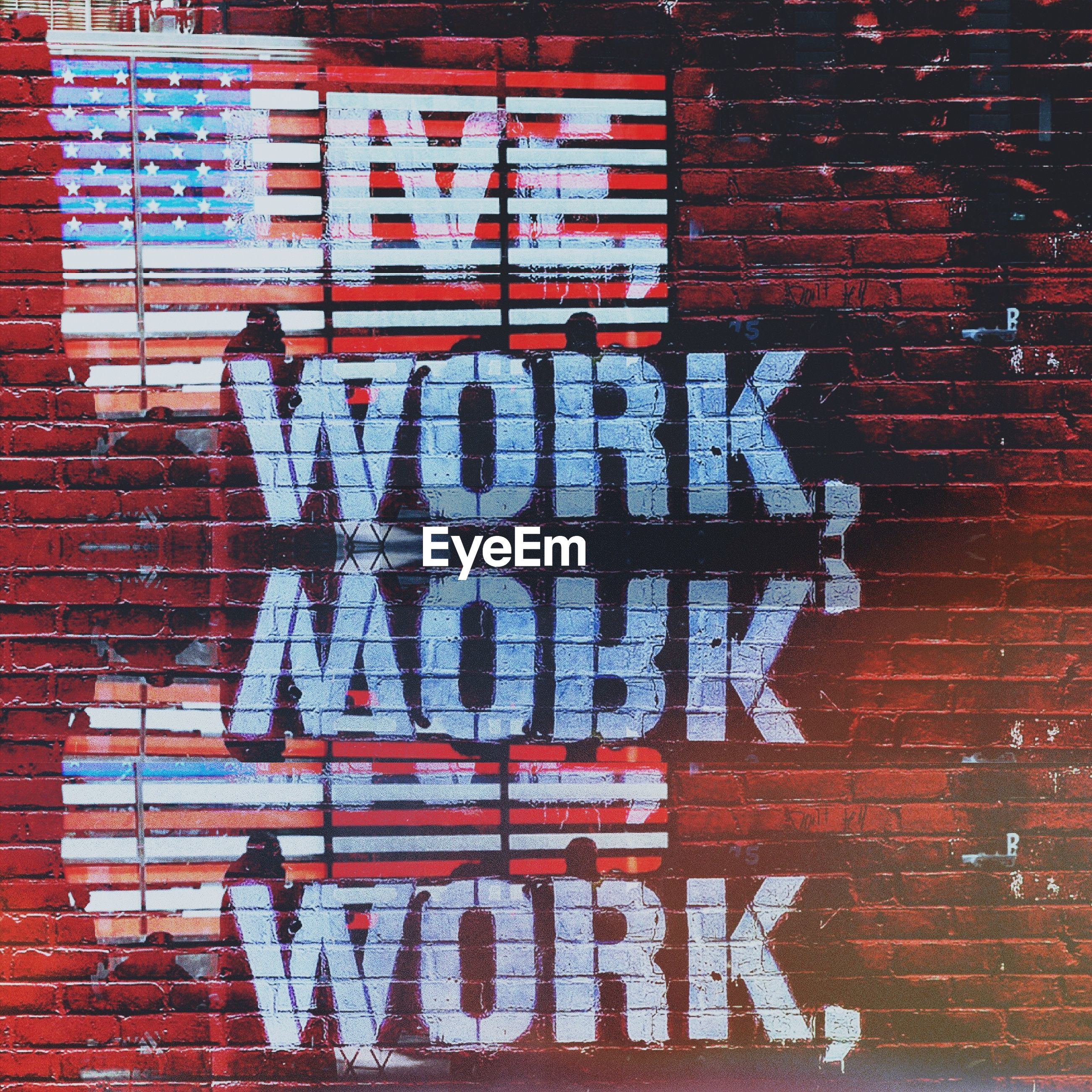Text on brick wall