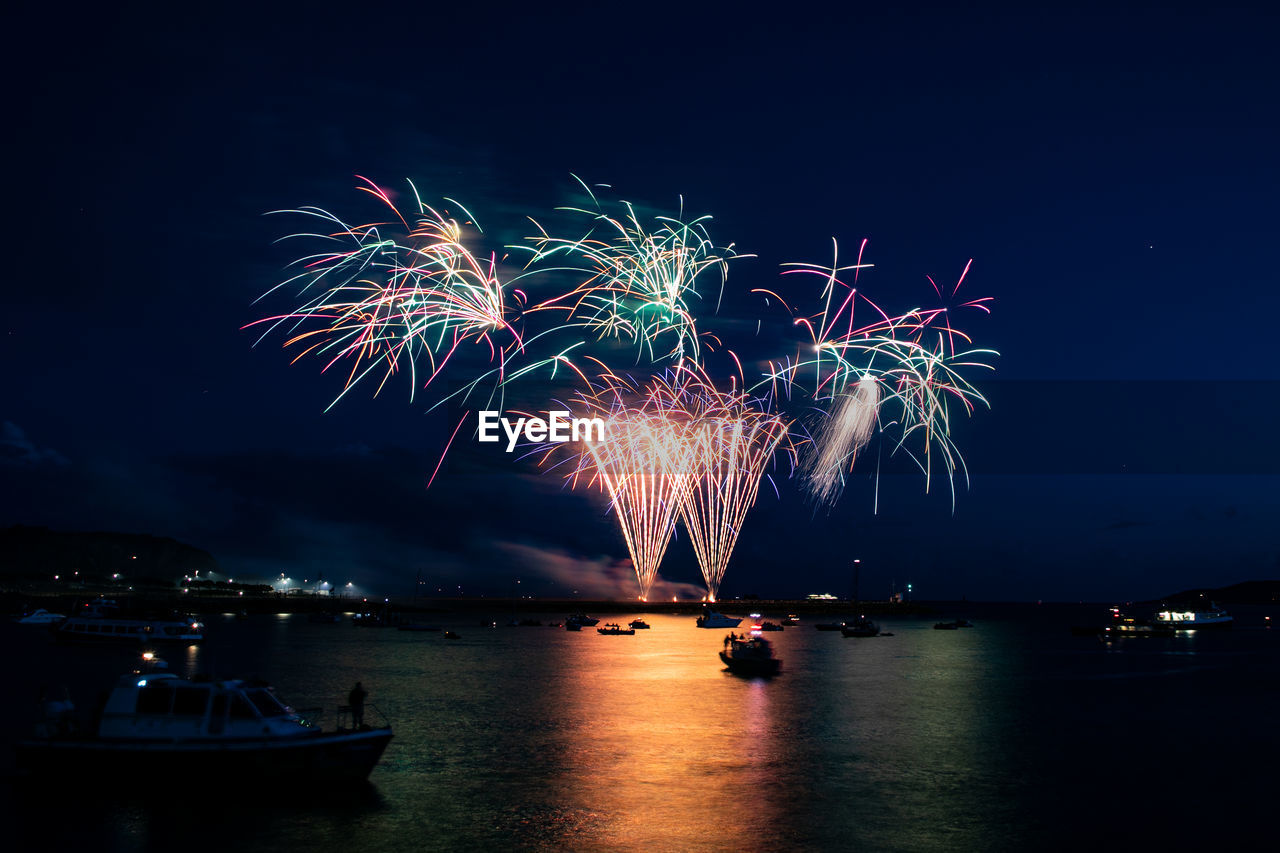 Firework Display Over Sea At Night
