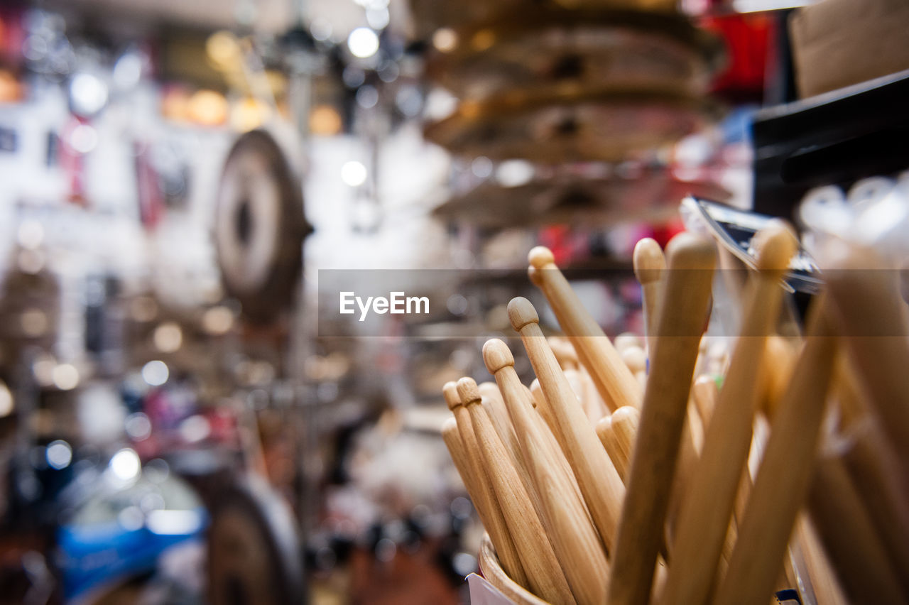 Close-up of wooden drumsticks in shop for sale