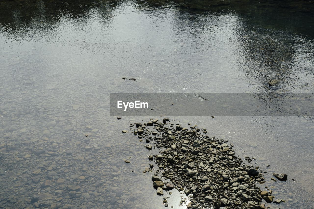 High angle view of stones at lakeshore