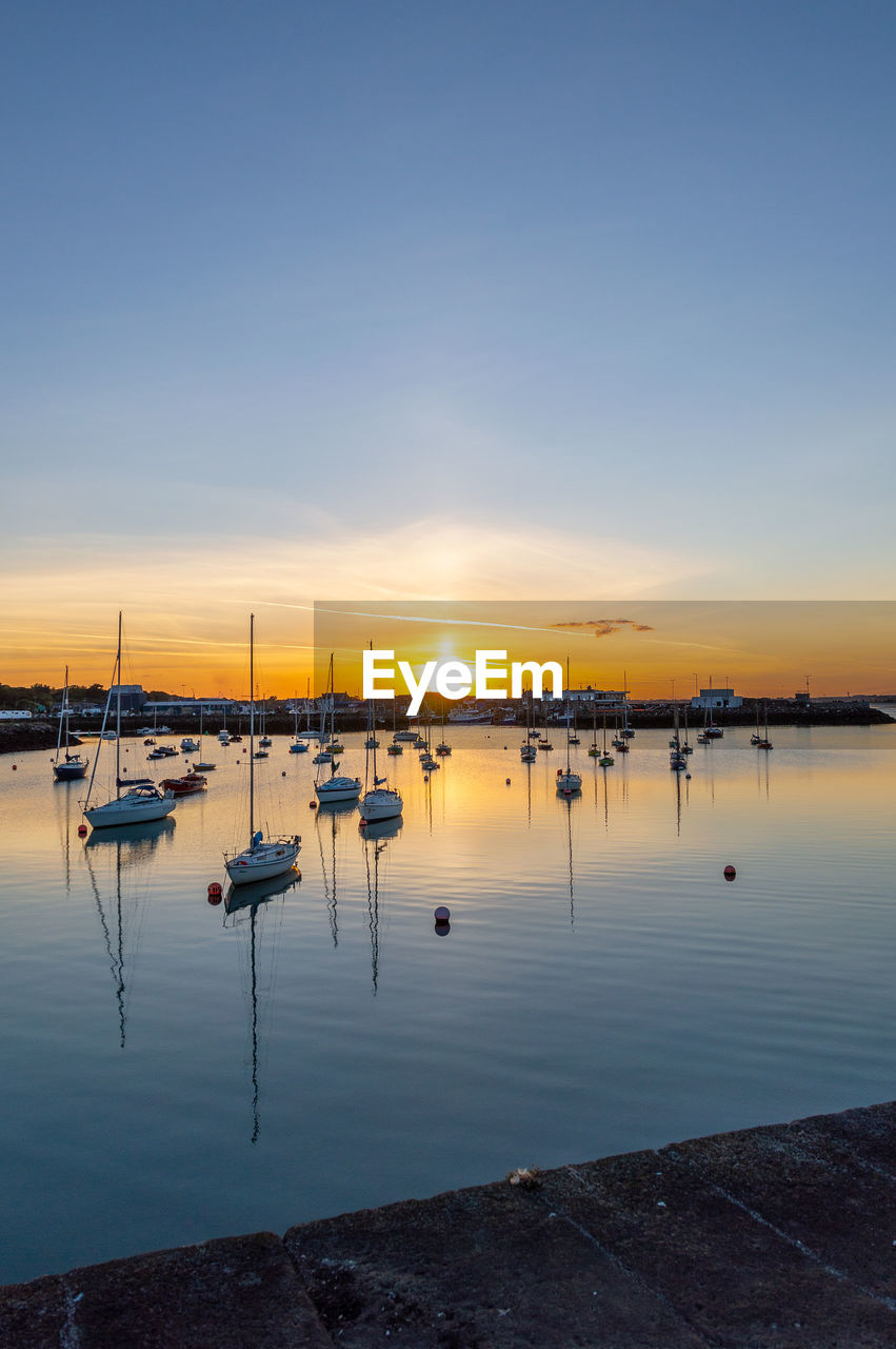 water, sky, sunset, nautical vessel, transportation, reflection, scenics - nature, mode of transportation, beauty in nature, tranquil scene, moored, tranquility, no people, orange color, sailboat, nature, sea, non-urban scene, outdoors, marina, yacht