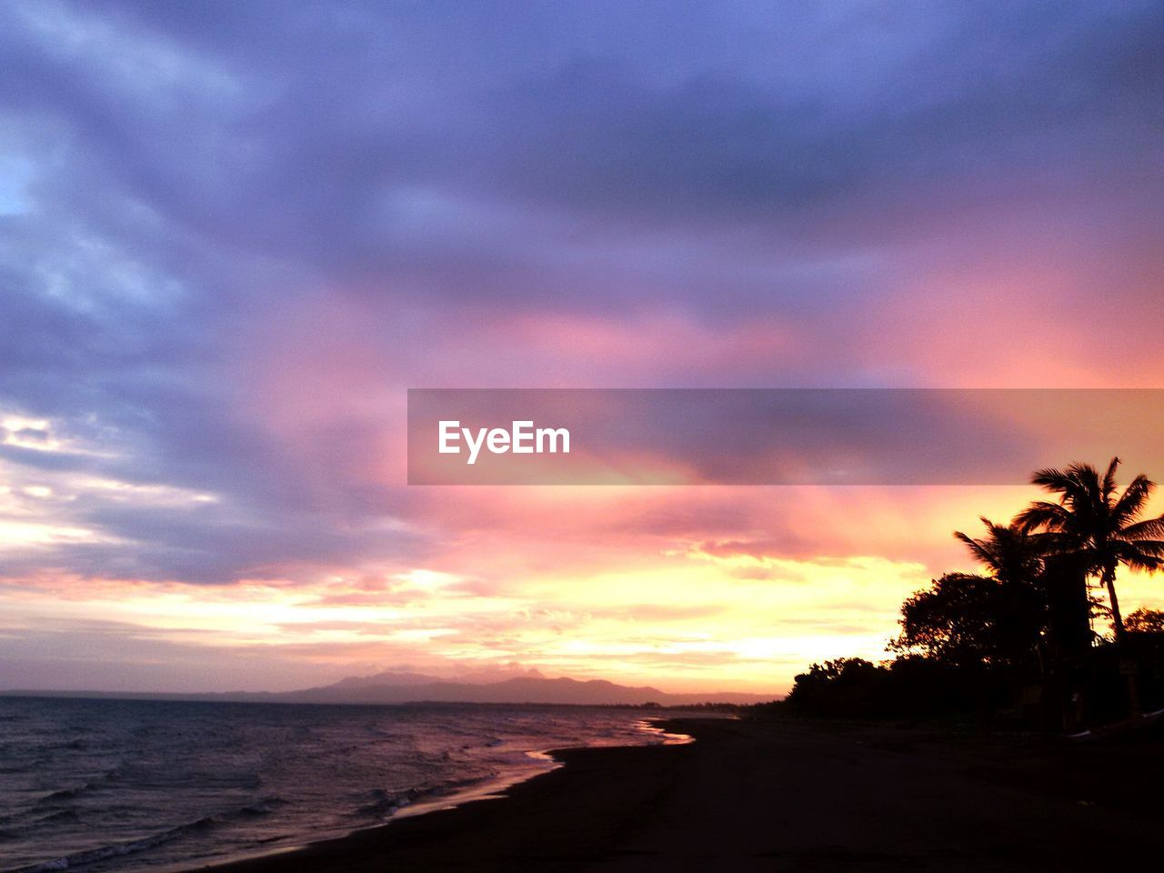 sunset, sea, beach, sky, silhouette, scenics, beauty in nature, nature, tranquil scene, water, tranquility, horizon over water, no people, holiday, outdoors, tree, palm tree