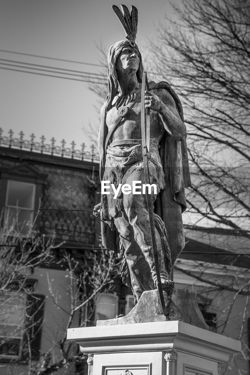 no people, low angle view, sculpture, statue, architecture, building exterior, sky, built structure, art and craft, day, nature, representation, human representation, creativity, craft, tree, male likeness, the past, female likeness
