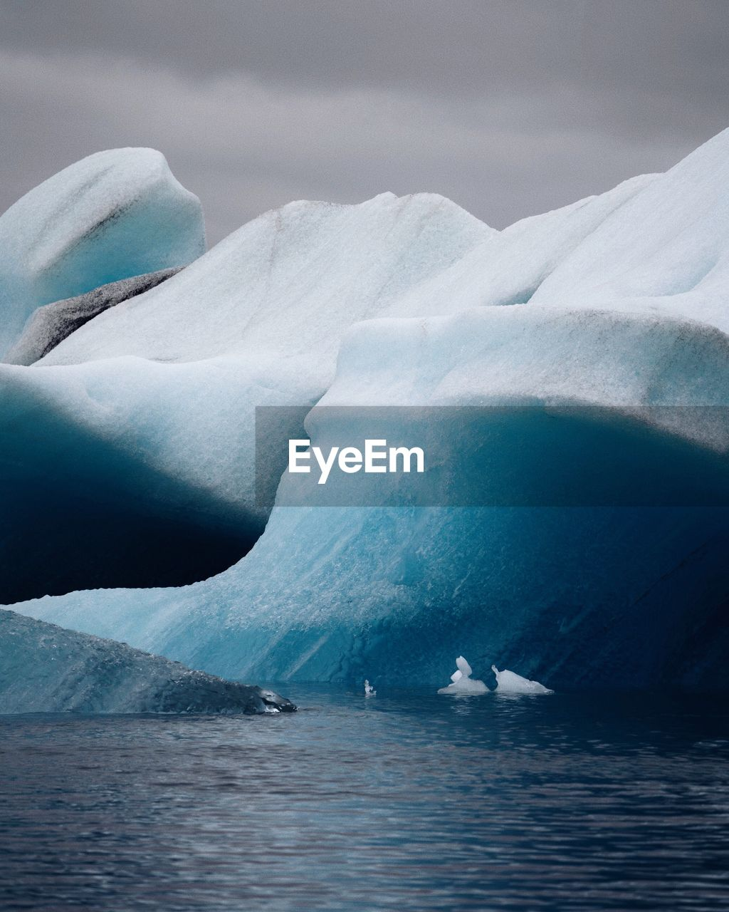 Iceberg In Sea During Winter