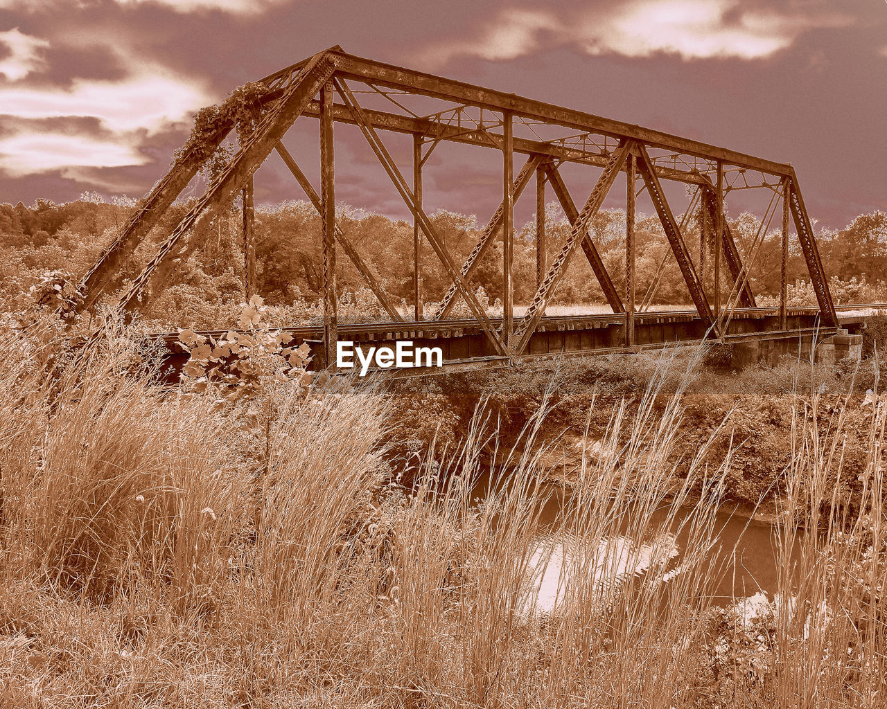 connection, bridge - man made structure, sky, outdoors, architecture, no people, grass, travel, day, landscape, transportation, cloud - sky, travel destinations, built structure, nature, water