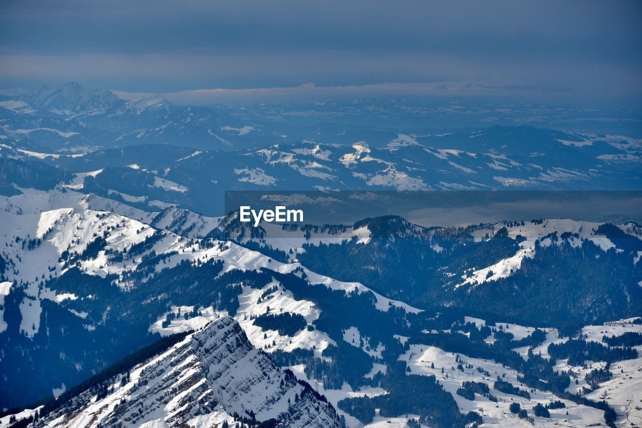 snow, cold temperature, mountain, winter, beauty in nature, scenics - nature, tranquil scene, environment, mountain range, tranquility, landscape, snowcapped mountain, aerial view, nature, non-urban scene, sky, no people, idyllic, day, outdoors, mountain peak