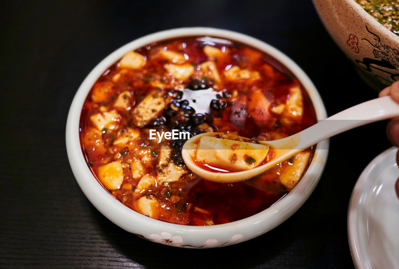 food and drink, food, bowl, spoon, freshness, eating utensil, ready-to-eat, kitchen utensil, table, indoors, close-up, healthy eating, wellbeing, serving size, still life, no people, high angle view, focus on foreground, asian food, temptation, vegetarian food, chinese food