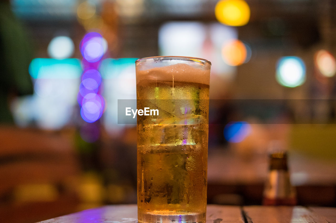 alcohol, drink, beer, beer - alcohol, refreshment, glass, food and drink, drinking glass, focus on foreground, household equipment, beer glass, table, close-up, still life, freshness, bar - drink establishment, no people, indoors, glass - material, business, pint glass, bar counter
