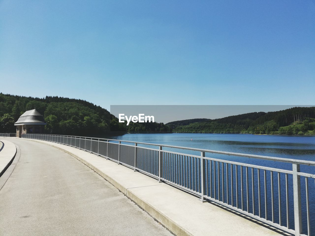 sky, water, copy space, clear sky, nature, railing, blue, day, mountain, transportation, no people, tranquility, connection, architecture, built structure, tranquil scene, beauty in nature, tree, scenics - nature, outdoors