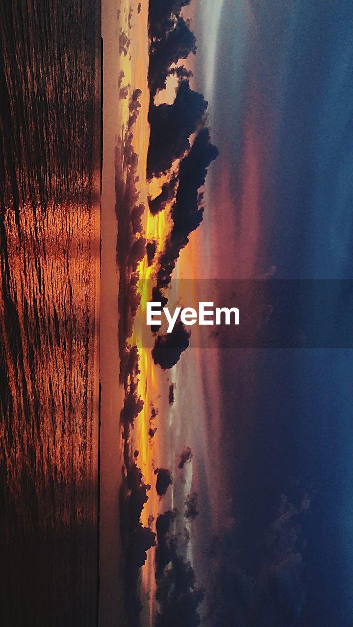 sunset, sky, water, sea, beauty in nature, tranquility, scenics - nature, tranquil scene, cloud - sky, nature, beach, no people, land, reflection, orange color, outdoors, horizon over water, idyllic, horizon