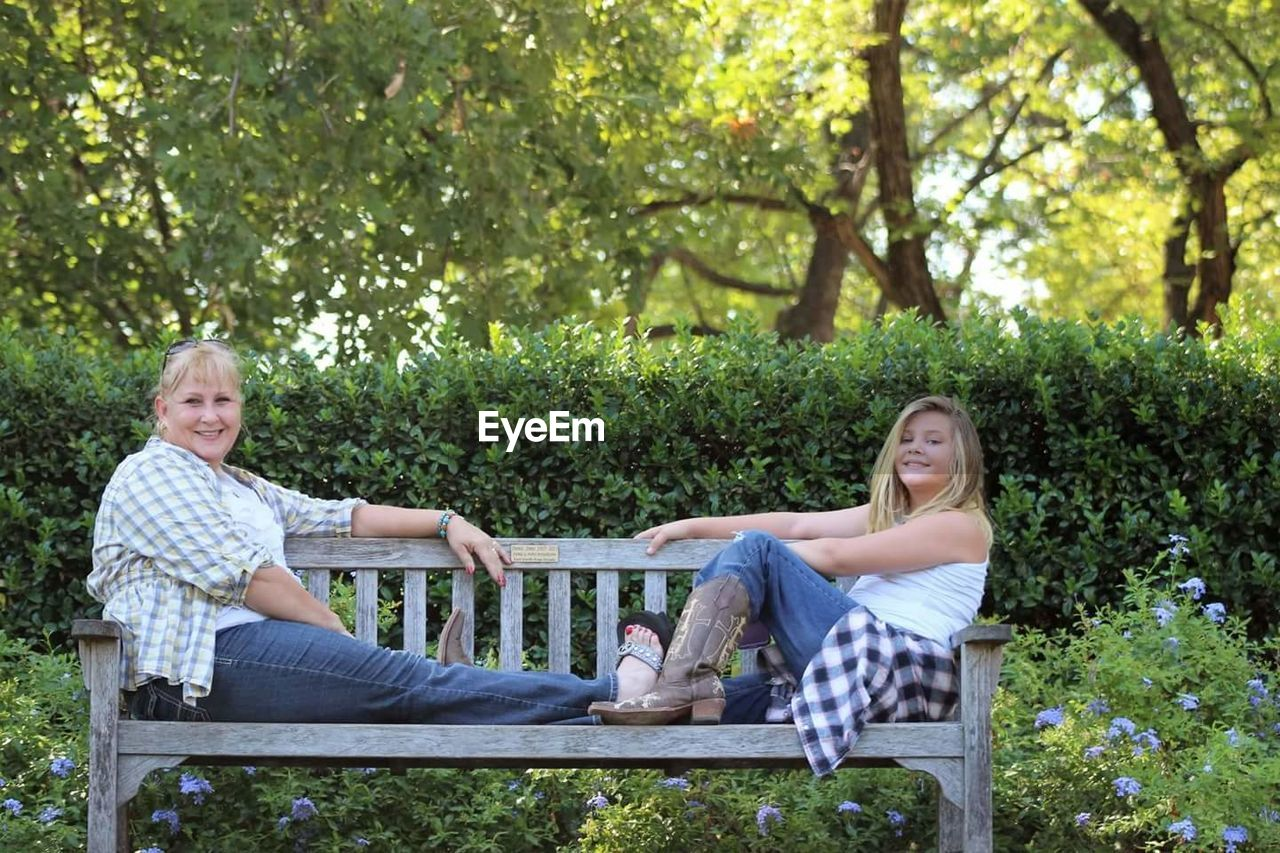 Portrait Of A Smiling Women And Girl On Bench