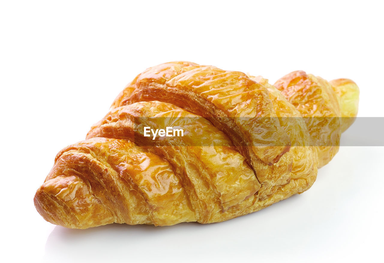 food and drink, white background, studio shot, food, still life, indoors, freshness, baked, croissant, no people, close-up, ready-to-eat, french food, bread, cut out, sweet food, plate, bun, indulgence, unhealthy eating, snack, breakfast, temptation