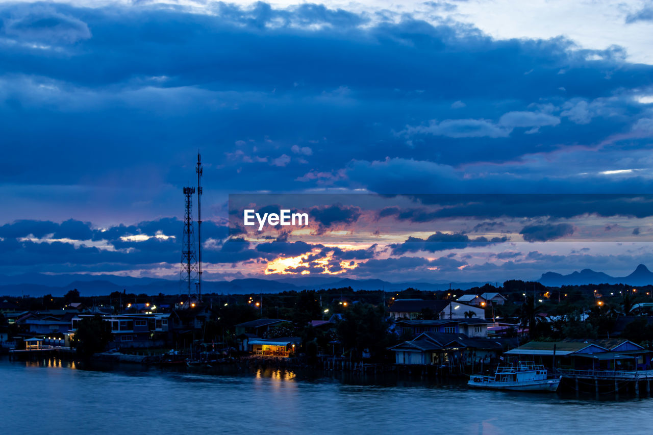 cloud - sky, sky, architecture, built structure, water, nautical vessel, building exterior, waterfront, sunset, no people, nature, building, illuminated, transportation, city, mode of transportation, beauty in nature, outdoors, dusk, sailboat