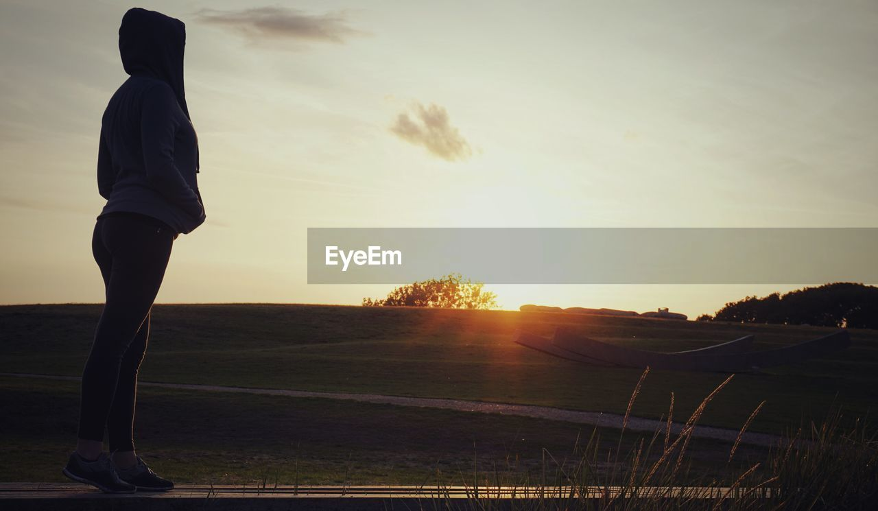 sky, sunset, one person, real people, leisure activity, lifestyles, nature, full length, beauty in nature, cloud - sky, standing, men, scenics - nature, water, tranquility, sport, side view, sun, land, outdoors