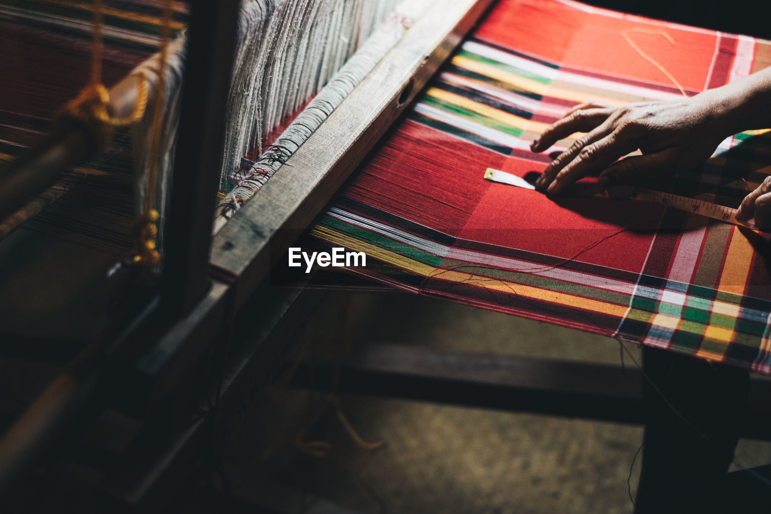 High angle view of woman working on loom