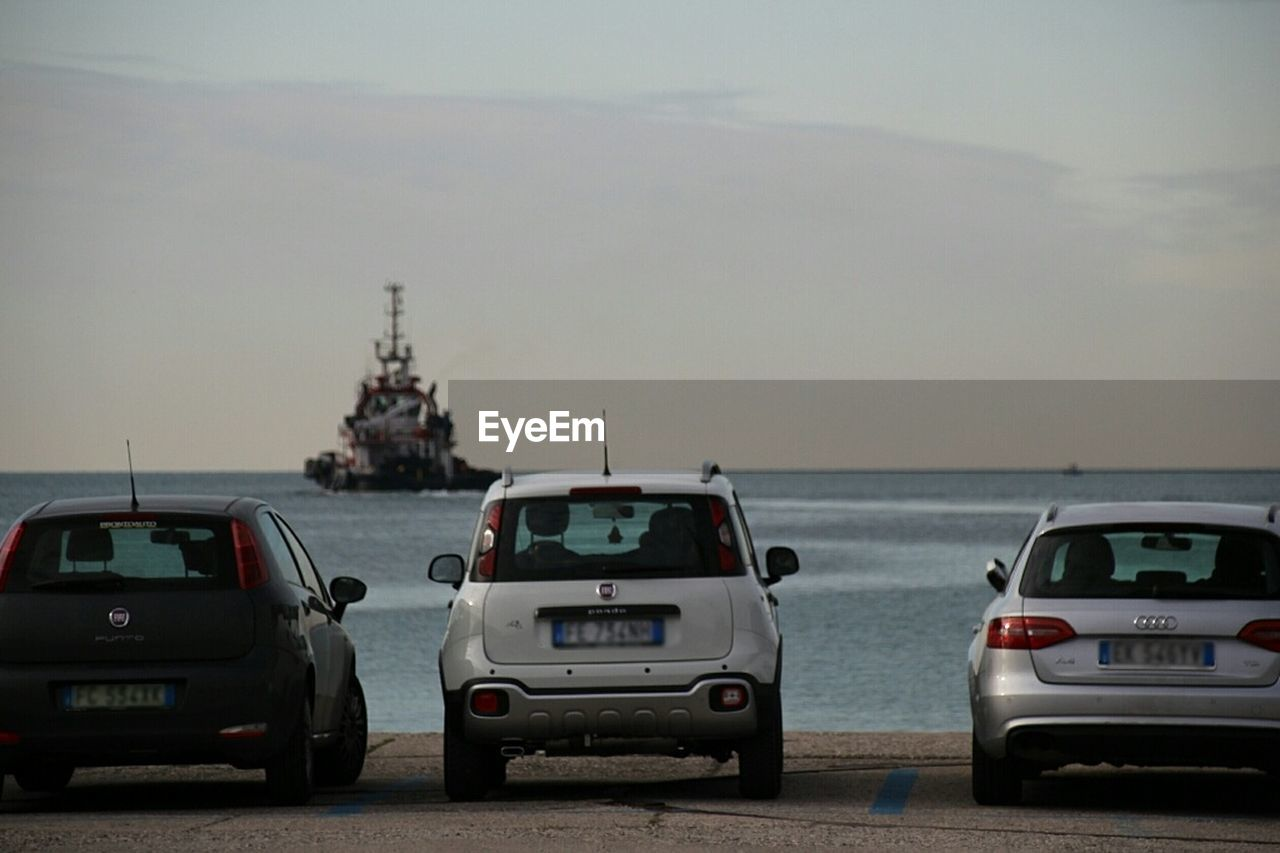 car, transportation, sky, land vehicle, mode of transport, sea, water, day, road, horizon over water, no people, outdoors, nature