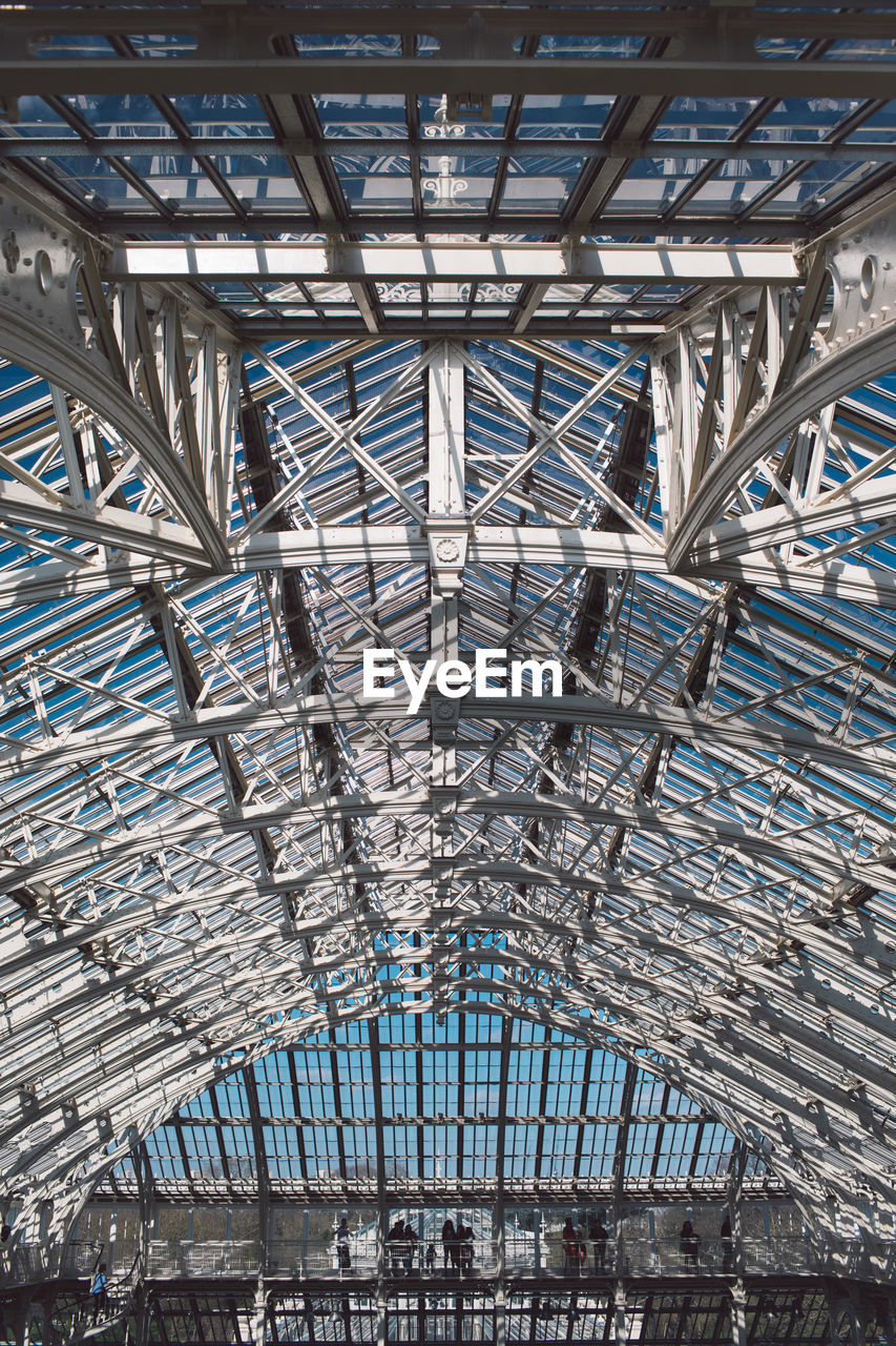 architecture, built structure, ceiling, metal, day, no people, pattern, roof, low angle view, indoors, full frame, travel destinations, backgrounds, repetition, sunlight, transportation, travel, wood - material, design, roof beam