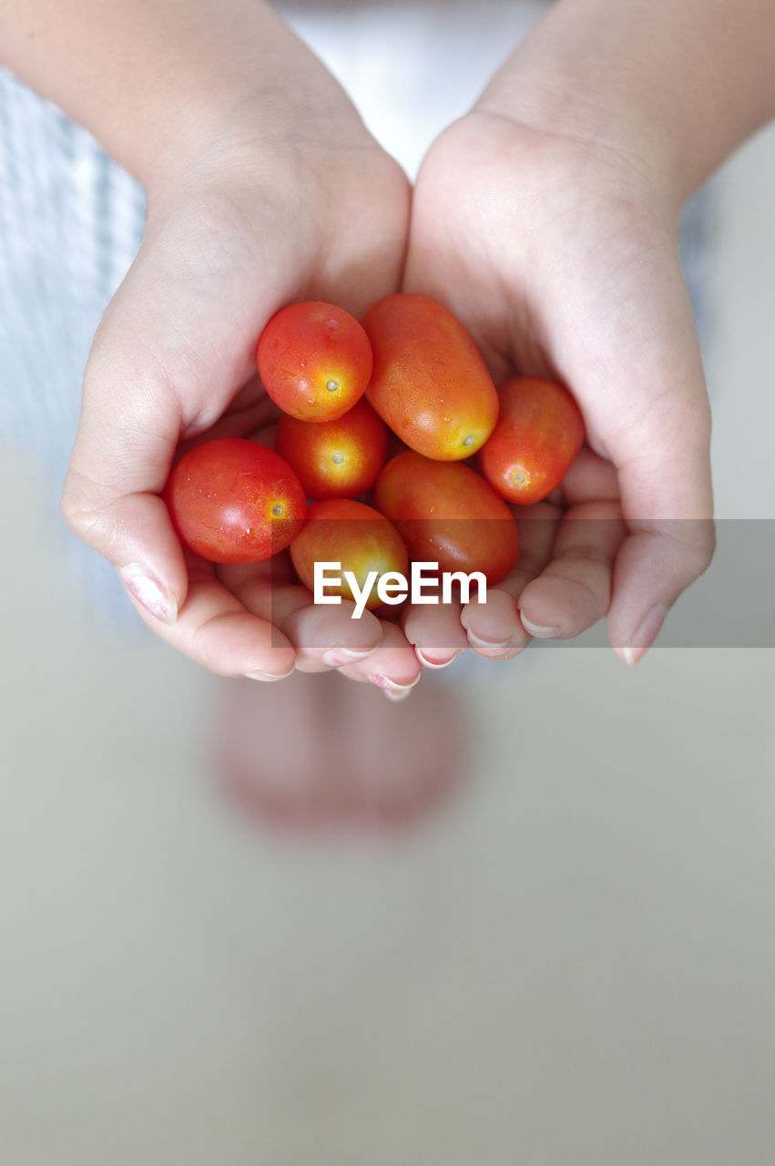 human hand, hand, fruit, holding, food and drink, one person, healthy eating, human body part, food, wellbeing, freshness, real people, red, lifestyles, unrecognizable person, close-up, hands cupped, body part, healthy lifestyle, finger, ripe