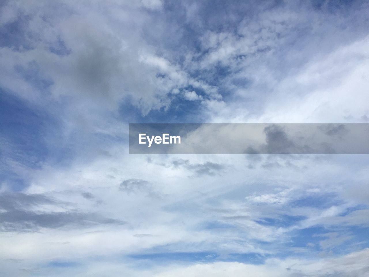 cloud - sky, sky, beauty in nature, low angle view, tranquility, scenics - nature, tranquil scene, no people, nature, backgrounds, blue, day, idyllic, outdoors, full frame, white color, non-urban scene, dramatic sky, cloudscape, meteorology, wispy
